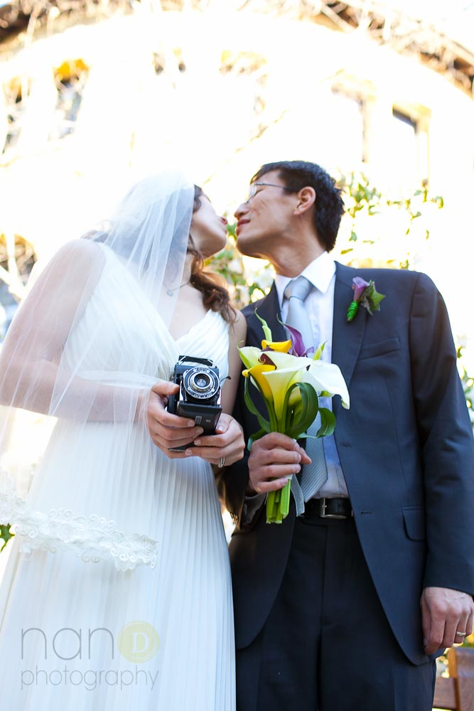 Bride and Groom with vintage camera at Stanford University